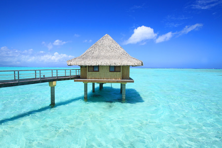 polynesia: overwater bungalow in turquoise water, French Polynesia Stock Photo