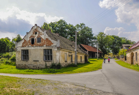 small village in Czech Republic showing decaying buildings, narrow roads