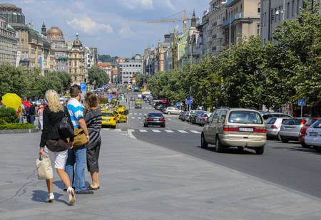 wenceslas square in prague showing the street, the park areas adn surrounding buildings