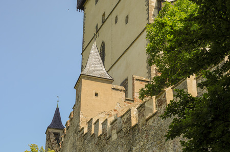 14th: Karlstejn Castle showing some of the architectural details of this 14th century gothic architecture including walls, ramparts, turrets Editorial