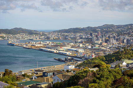 Passed out: Iconic views of Wellington city in New Zealand. Looking south from Kkandallah towards the city centre, the port and harbour and passed the southern hills and out to Cook Strait