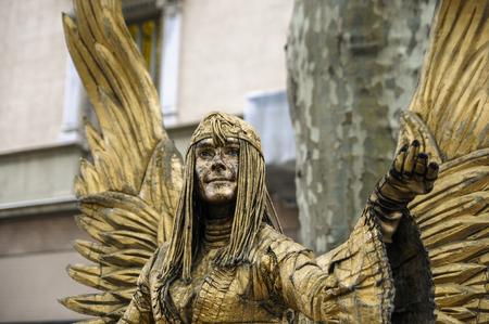 the ramblas: A golden angel  living statue in Las Ramblas, barcelona.