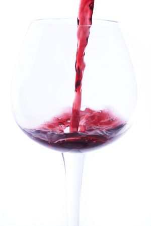 Wine is poured into a glass Stock Photo