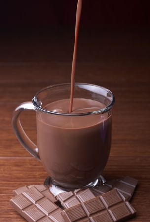 hot chocolate drink: A mug of hot chocolate is poured from above Stock Photo