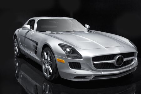 Silver sports car on a black background. Stock Photo - 6512392