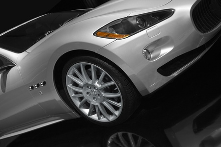Silver sports car on a black background. Editorial
