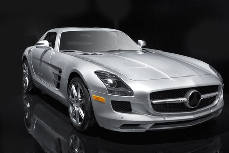 expensive: Silver sports car on a black background. Editorial
