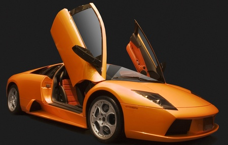 orange sports car on a black bacground