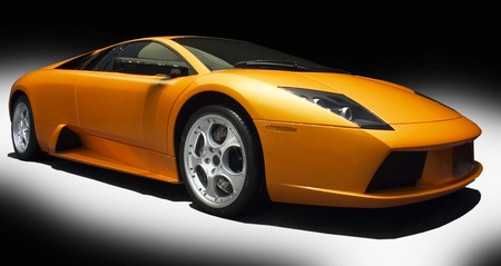 fast car: orange sports car on a black bacground