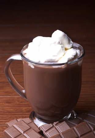 hot chocolate drink: A mug of hot chocolate sits on a table.
