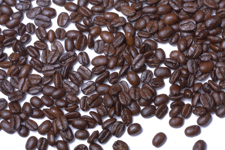Coffee beans scattered on a white background Stock Photo