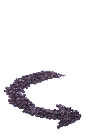 Coffee beans arranged in arrow form on a white background