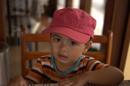 impoverished: Asian Boy with cap