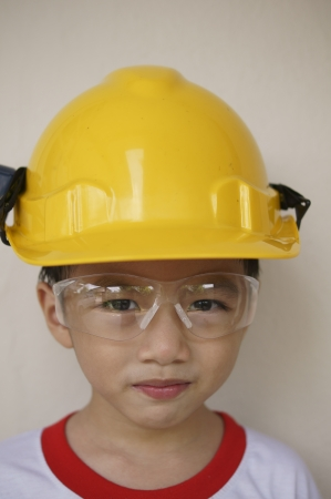 Young Asian boy on hard hat photo