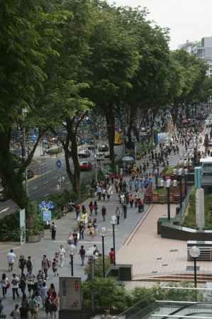 Orchard Road, Singapore - December 29,2011:Crowd on the pedestrian of Orchard Road, Singapore. Stock Photo - 14444431