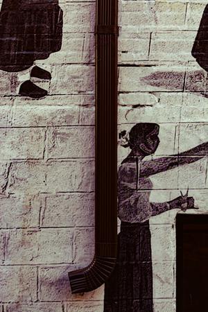 art behind a rain gutter