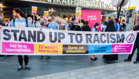 Protesters holding placards & posters at the March Against Racism national demonstration, Stratford, London, UK, in protest of the dramatic rise of acid race related attacks.