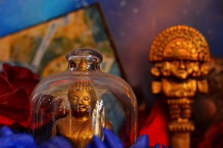 Colorful Buddhist statues with a beautiful background.