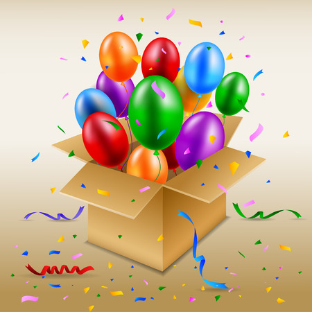 Open cardboard box with birthday balloons