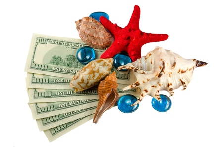 Shells starfish and water drops on dollars isolated photo