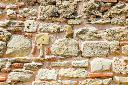 exterior architectural details: old wall consisting of a sandstone and bricks Stock Photo