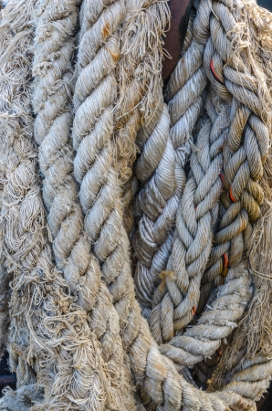 old thick obsolete nautical rope of ship photo