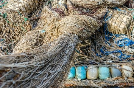 Heap of old fishing nets with floats close-up photo