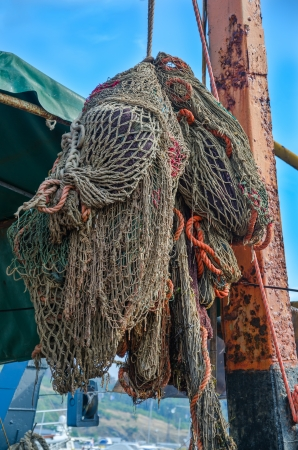 Old fishing nets of the fishing ship photo