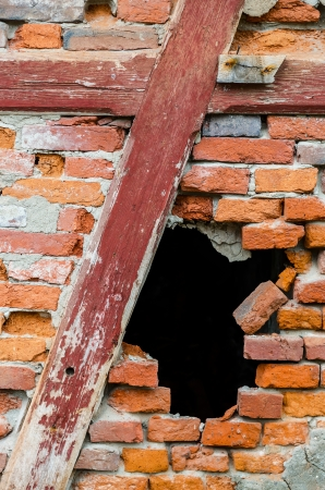 Black hole in a red brick wall photo