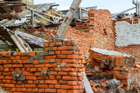 demolished: Destroyed industrial building constructed of red bricks on crisis time