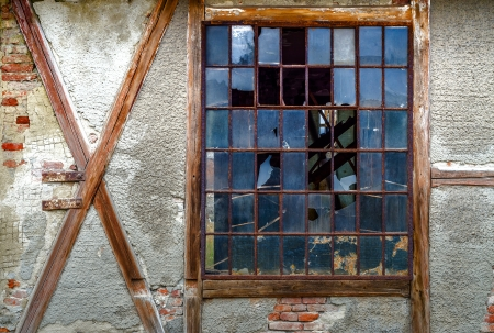 Old broken window in red brick wall photo