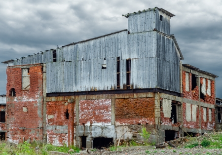 Аbandoned industrial building constructed of red bricks on crisis time photo