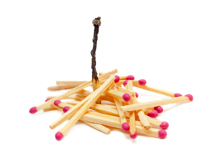 burned out: Wooden matches with one burned out, isolated on white background Stock Photo