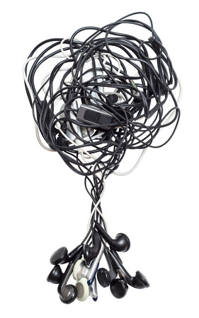Heap of old earphones isolated on white  photo