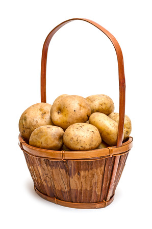 Yellow potatoes in the basket isolated on white background photo