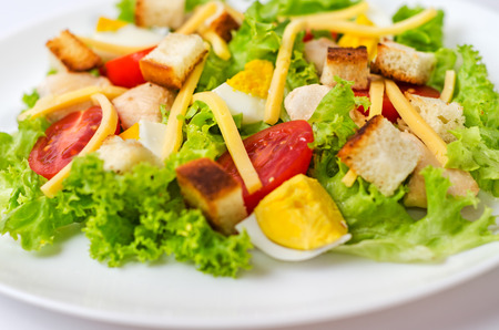 chicken caesar salad: Classic Chicken Caesar Salad with tomato close-up