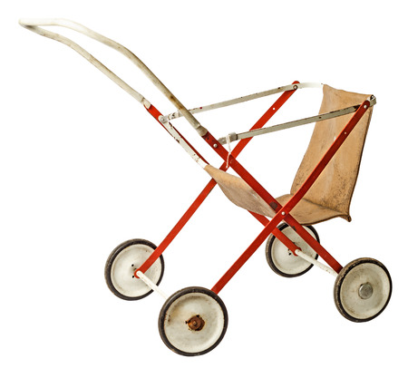 Old doll stroller isolated photo
