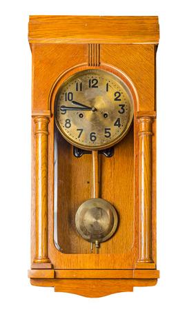 Antique wooden horizontal wall pendulum clock isolated on white background