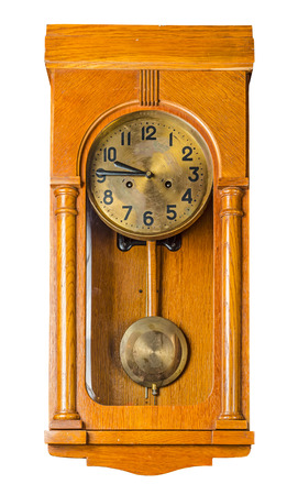 Antique wooden horizontal wall pendulum clock isolated on white background photo