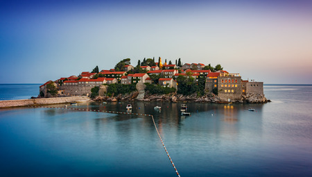 Old town of Sveti Stefan in Montenegro after sunset photo