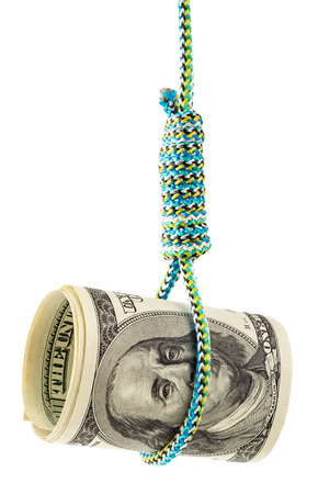 tough times: Money debt and credit. Rolled dollars in a noose depicting tough economic times, devaluation, recession and financial collapse.