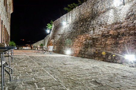 Restaurant on fortress of old town Budva at night photo