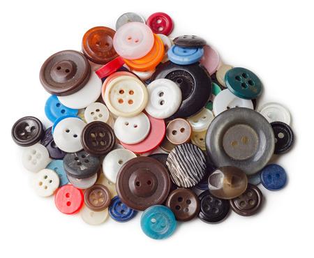 used clothes: Pile of old and used clothes buttons isolated on white background