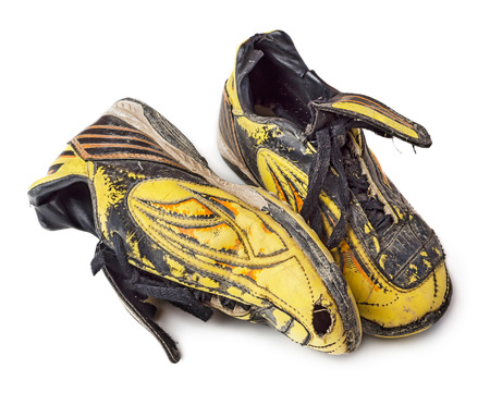 football shoes: Pair of dirty football shoes. Soccer boots. Isolated on white background.