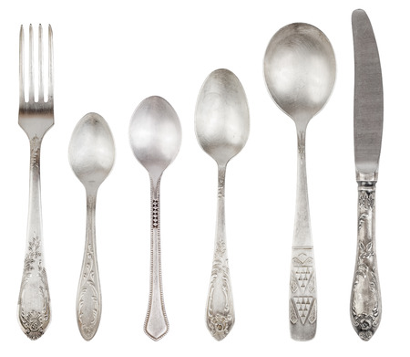 silver cutlery: Aged vintage silver cutlery (fork, knife, spoons) isolated on white background. File contains a clipping path.