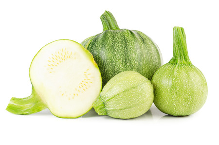 courgettes: Heap of raw courgettes isolated on white background