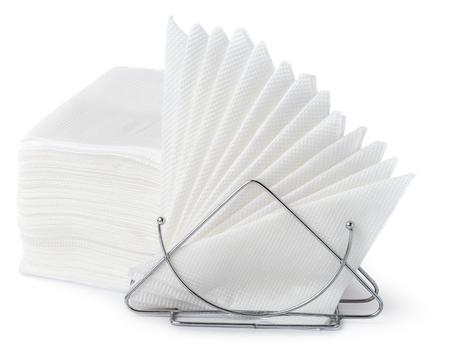 white napkin: A table napkin holder with white napkins isolated on white background. Pile of napkins Stock Photo
