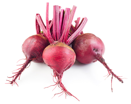 bulb and stem vegetables: Three red beetroots isolated on white background.