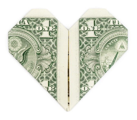 dollar bill: Dollar folded into heart isolated on white background. Valentines heart.