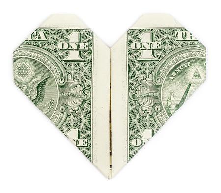 dollaro: Dollaro piegato in cuore isolato su sfondo bianco. Il cuore di San Valentino.